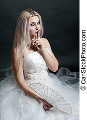 Beautiful girl in white dress on black background -...