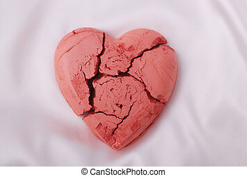 heart  - A red broken heart on a white background