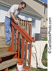 Painter Painting Deck - Contract painter staining deck on...