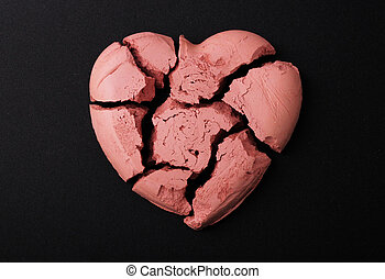 heart  - A red broken heart on a black background