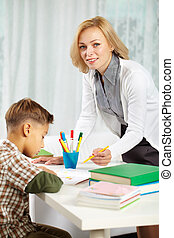 Tutor with pupil - Portrait of pretty tutor looking at...