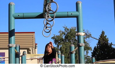 Girl On Old Style Playground Rings - A cute little 5 year...