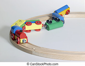 accident of a wooden toy train - studio photography of a...