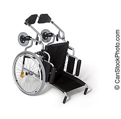 toppled down wheelchair - studio photography of a turn over...