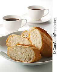 French bread and coffee - French bread and white cup of...