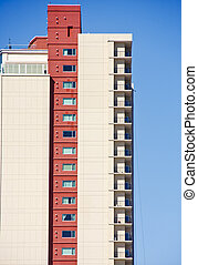 Condo Tower From Side with Red Column