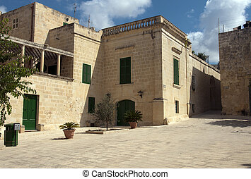 the old city valetta - street and houses from stone in the...
