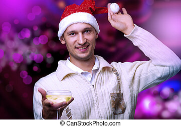 Young adult man in santa claus hat