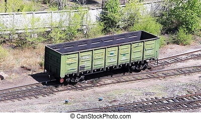 Railroad freight wagon going down on the switchyard