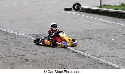 Go-kart racing in russian town. Warm up lap with single kart