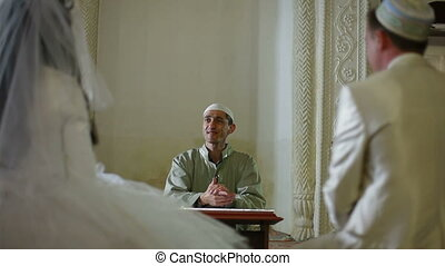 Nikah in Mosque - Imam islamic priest preaching at the...