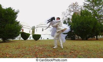 groom spinning around  bride