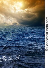 Stormy sea - Stormy depp blue sea, dark sky, sun shines...