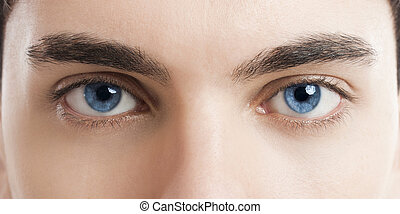 Blue eyes - Close-up picture of blue eyes from a young man