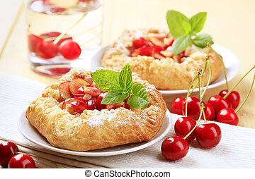 Danish pastry topped with fresh cherries - detail