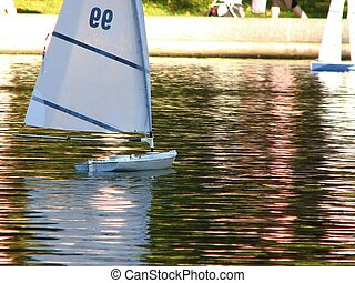toy sailboat on the water - a shot of a toy remote control...