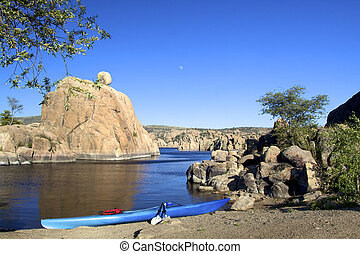 Scenic Lake and kayak - full moon rises over watson lake in...