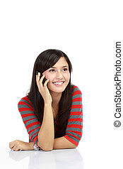 Good looking asian girl talking and smiling on a hand phone....
