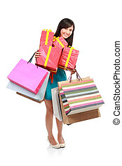 Young woman holding shopping bag and gift box. Isolated...