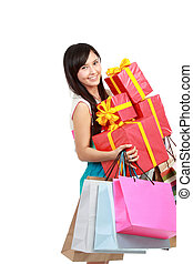 Happy shopping girl holding bags and gift box, full length...