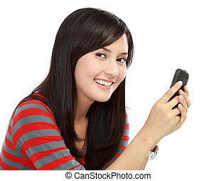 young asian woman holding her mobile phone and messaging...