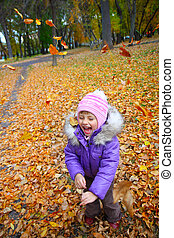 happiness a child smiling in the autumn park