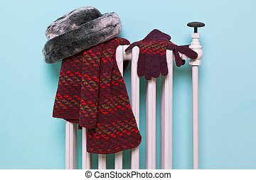 Womans hat scarf and gloves drying on a radiator
