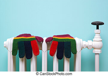 Striped woolen gloves on old radiator