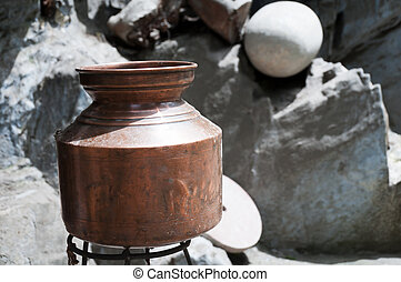 Old hammered brass vessel for open fire cooking