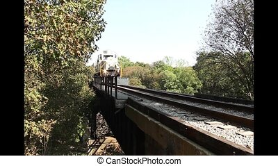 diesel passenger train on trestle - A diesel passenger train...