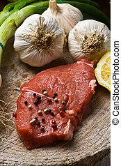 Fillet Mignon - Fillet Mignon on wood with pepper and garlic...
