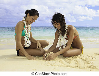 two girls playing in the sand