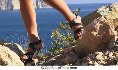 Heels in the mountains - Two girls in high heels standing on...