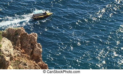Boat floats on the sea - Small boat sailing on the mighty...