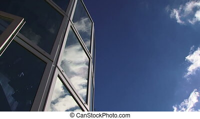 Reflected in skyscraper - Beautiful blue skies with a few...