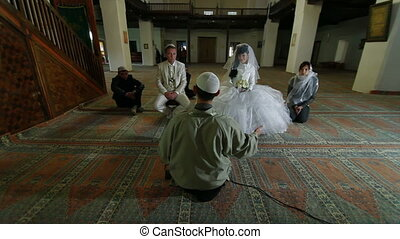 Wedding Ceremony of Crimean Tatars - Imam (islamic priest)...