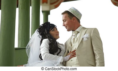 Islamic wedding - Young Crimean Tatar couple on the steps of...