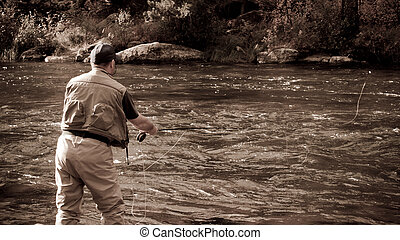Fly Fisherman - Fly fisherman at Taylor River, Colorado