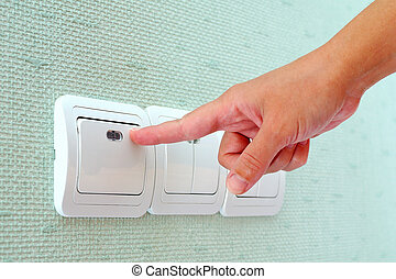 Turning off or turning on the wall-mounted light switch