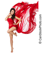 Woman dancing in red flying waving chiffon dress as wings on a wind flow. Over white background