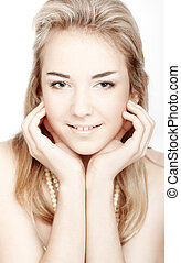 Beautiful girl with clean skin touching face. Closeup over white background