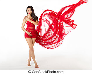 Woman in red flying waving dress as wings on a wind flow...