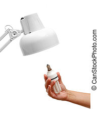 Energy saving light bulb in hand and lamp isolated on white background