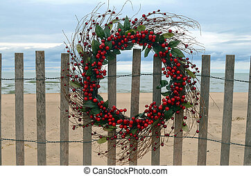 Holiday Berry Wreath - Christmas berry wreath hanging on a...