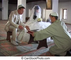 Islamic wedding ceremony in mosque Nikah - groom signed...