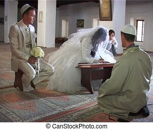 Islamic wedding ceremony in mosque Nikah - bride signed...