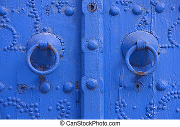 Oriental beautiful blue knocker and traditional door in...