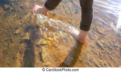 Barefoot in water - Woman splashing barefoot in water