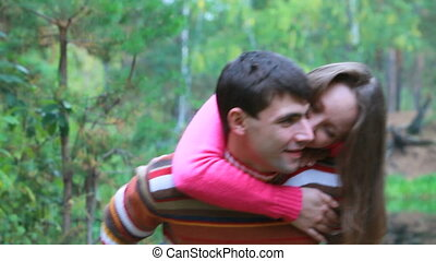 Valentines - Girl jumping at her boyfriend and them kissing