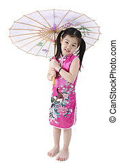 Little oriental girl in traditional Chinese dress cheongsam...
